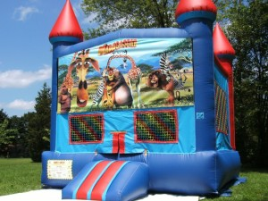 Big-Bounce-Rentals-Red-and-Blue-Castle-Madagascar-Theme-1