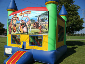 Big-Bounce-Rentals-Rainbow-Castle-Madagascar-Theme-1